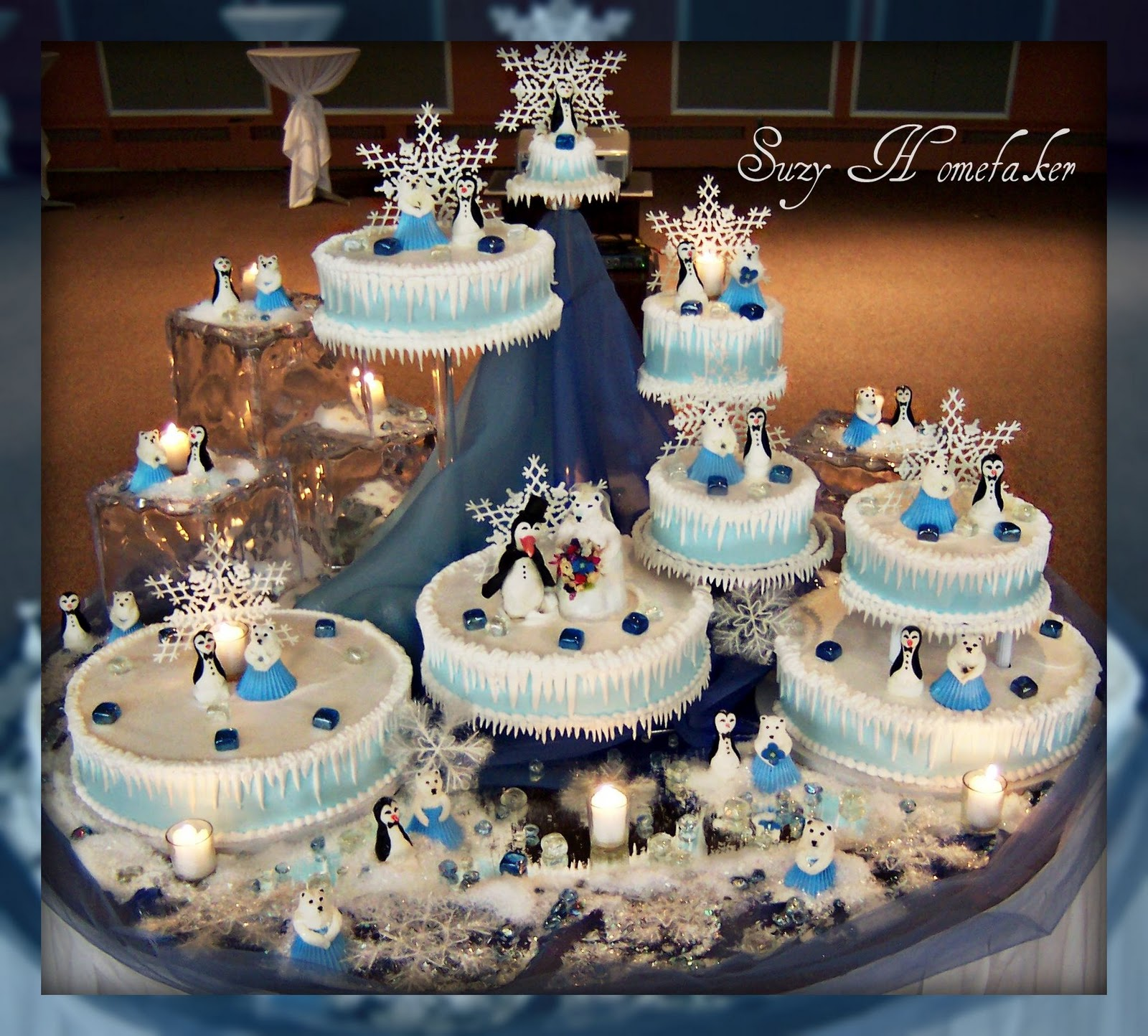 This Whole Cake Was Set Up On A Table Of Mirrors To Reflect The Candle Glow Large Acrylic Ice Cubes Anchor Es In Back Blue Tulle And Organza