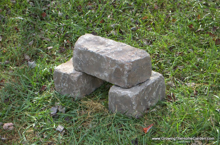 A Simple seat made from stone retaining wall blocks.