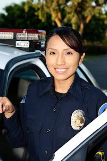 Female Constable exiting a patrol car.