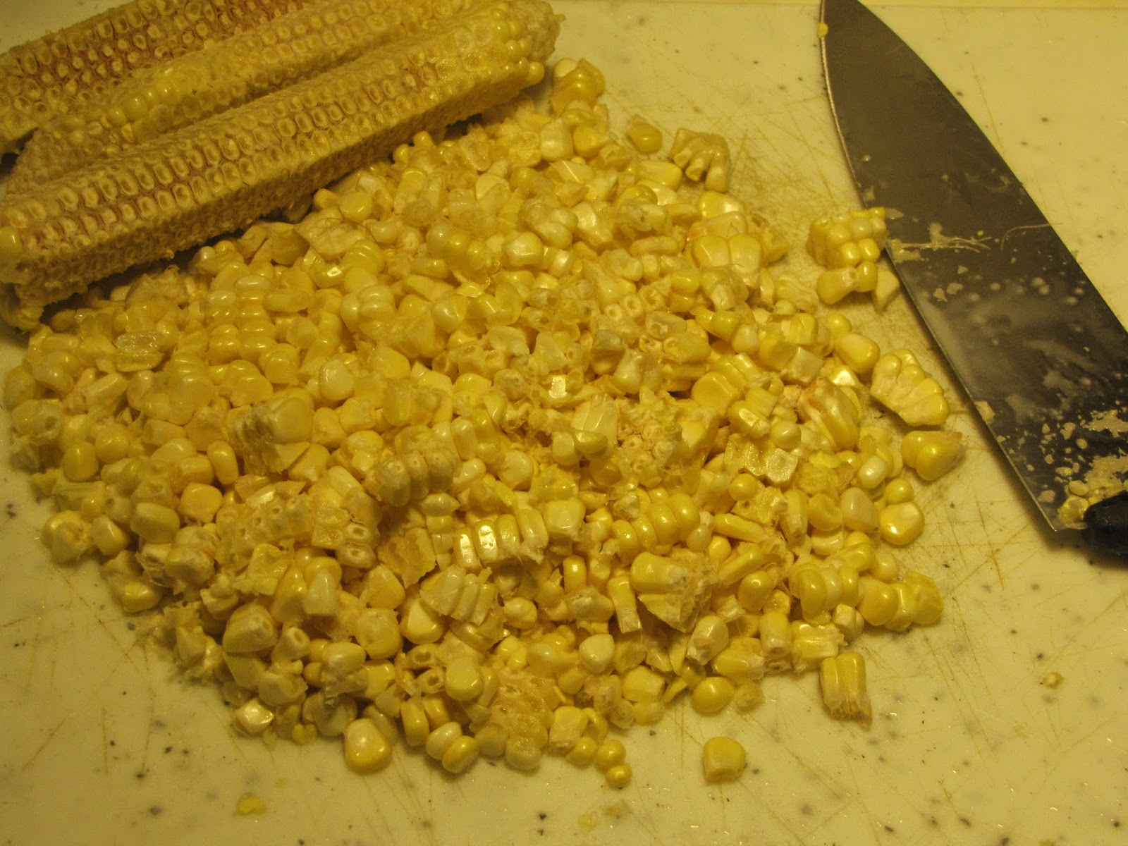 Corn kernel cut off the cob with a sharp knife