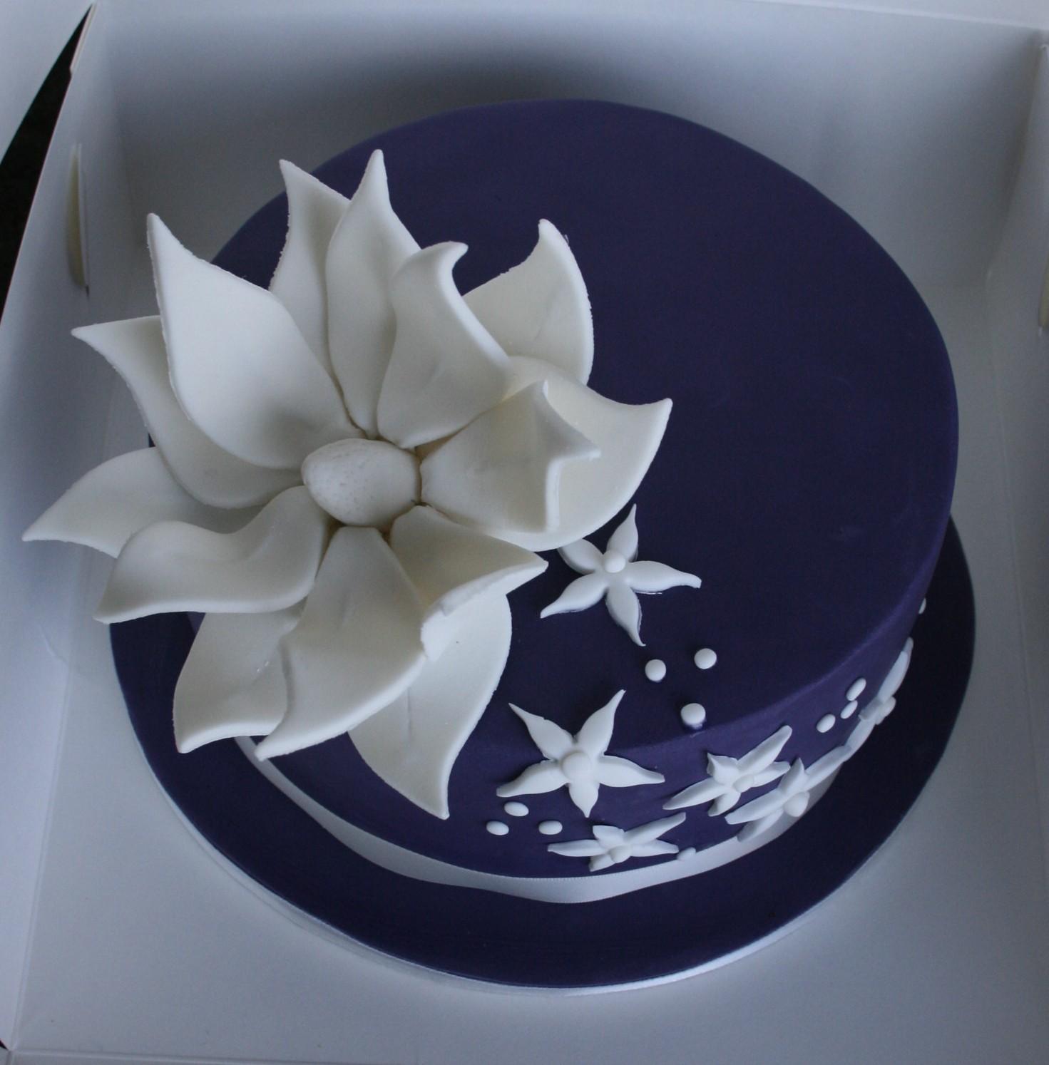 An elegant simple cake made in the birthday girls fav colours.