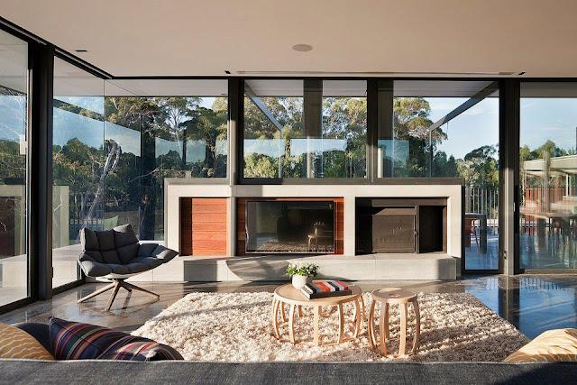 Soft Fabric Sofa, Fur Rug, Light Wood Round Coffee Table, Grey Armchair and Fireplace