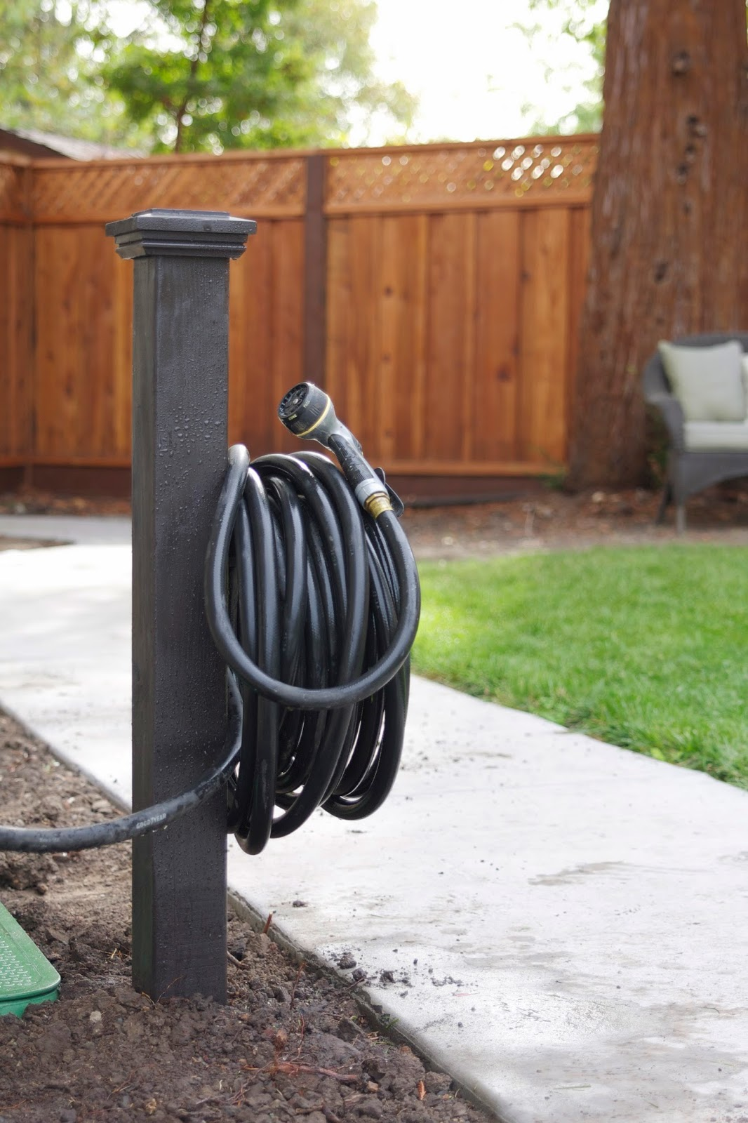 I did the exact same thing for the hose in the front yard for Diy garden hose storage