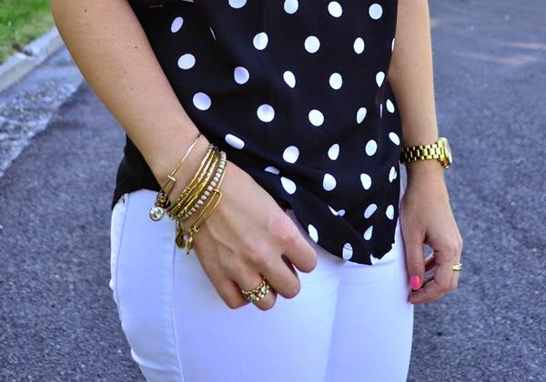 polka dot shirt, white jeans, black heels, gold jewelry