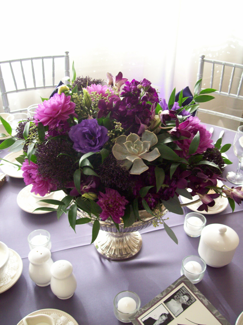 silver grecian urn vase, sweet pea floral design, ann arbor, michigan florist centerpiece purple dahlia, orchid, succulent, rose, seeded eucalyptus, echevaria, stock, trachillium, lisianthus, footed urn vase, travis point country club