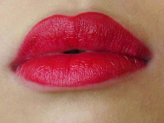 red lipstick swatch on lips