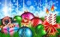 Velas encendidas y regalos de Navidad para compartir