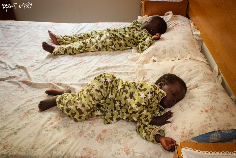'Sudanese twins take an afternoon nap' Brent Lukey 2009.