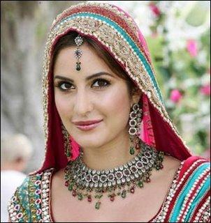 Looking Katrina Kaif in a sky blue and red shading bridal dress