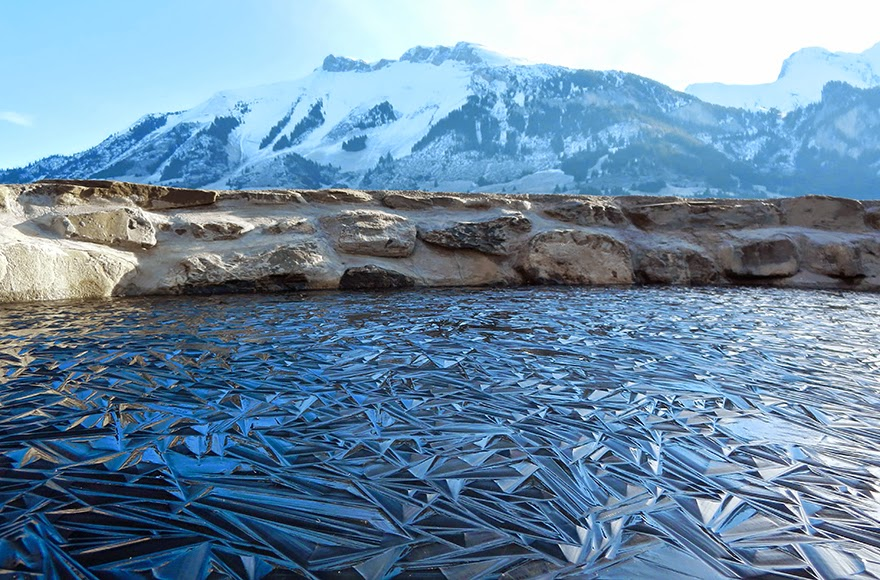 14. Frozen Pond In Switzerland - 18 Beautiful Frozen Lakes, Oceans And Ponds That Resemble Fine Art