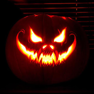 Jack o lantern with face blazing from inner candle
