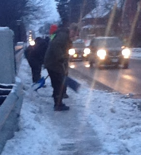image snow shovelling dangerous traffic narrow sidewalk