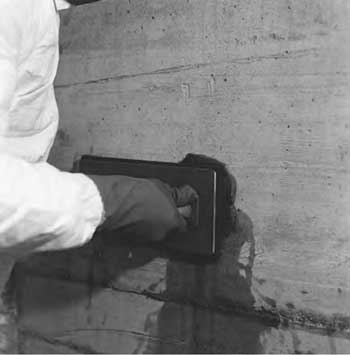 Patching of concrete substrate prior to waterproof- ing application.