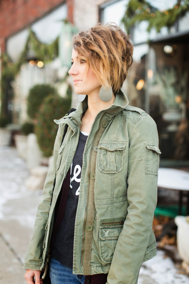 military jacket, graphic tee, and converse