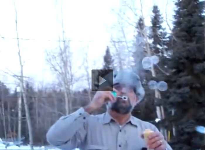 A Canadian Couple Blows Bubbles In -45 Celsius Weather
