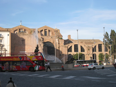 An-open-air-hop-on-hop-off-tour-bus-Rome-Italy