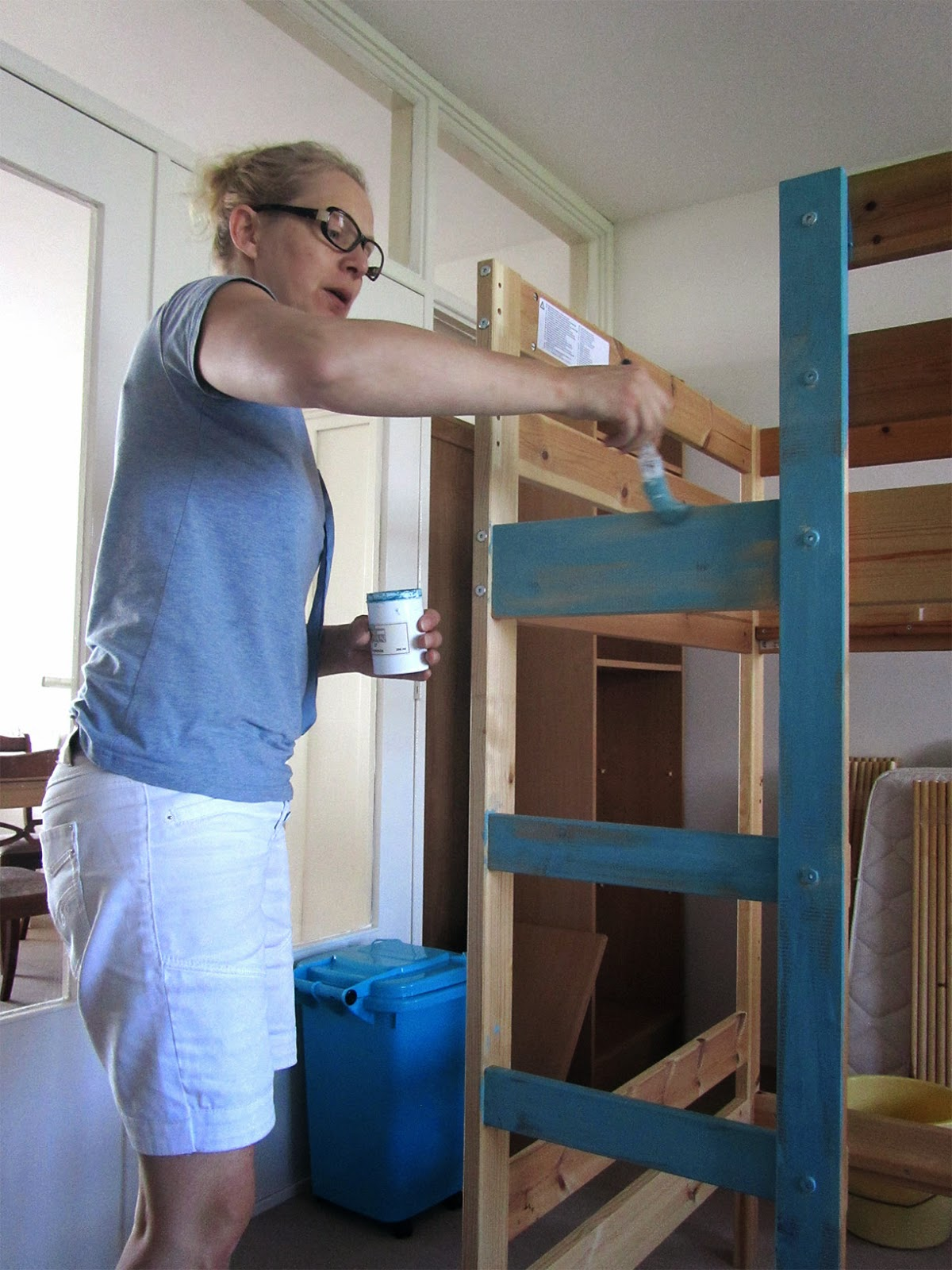 my sister painting the bunk bed