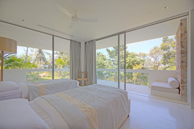 Picture of modern bedroom with two beds and glass walls