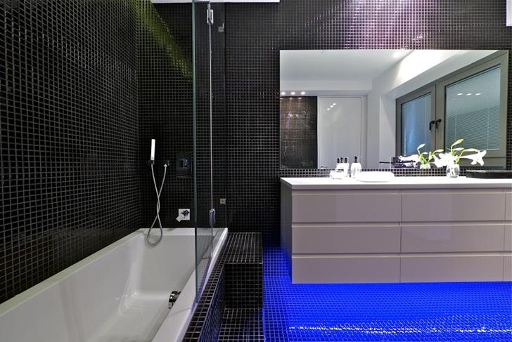White modern furniture in black bathroom
