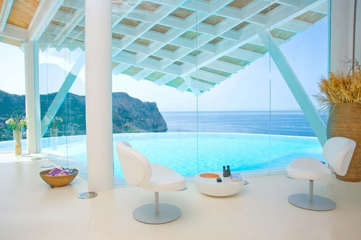 Glass walls of Mediterranean villa in Mallorca by Alberto Rubio