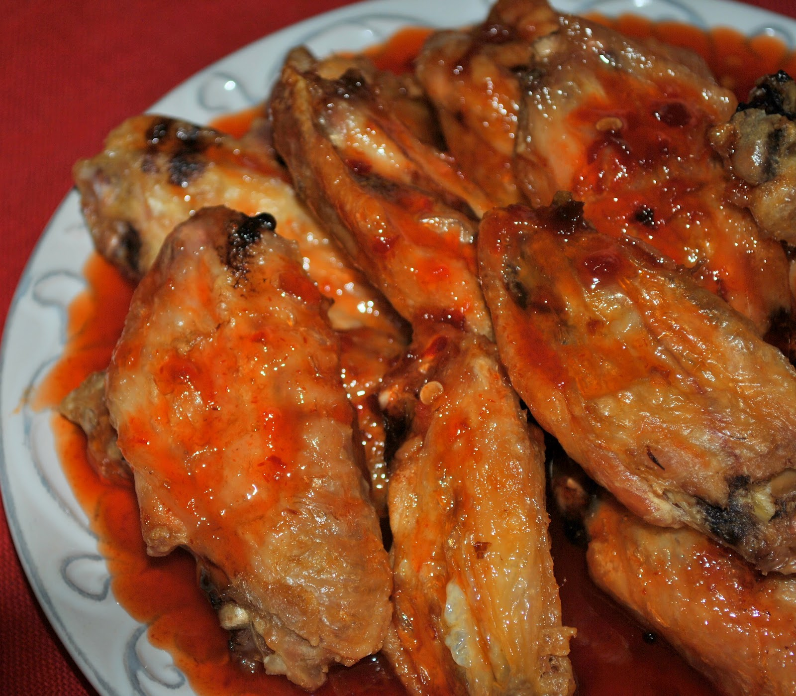 ... : sticky.. sweet... spicy... messy.. honey sriracha chicken wings