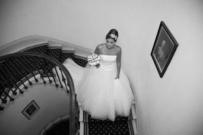 Bride on the spiral staircase at Wynyard Hall