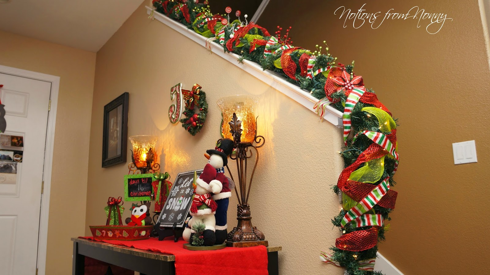 Decorating banisters for christmas with ribbon - It Is The Hardest Banister I Have Ever Had To Decorate So Not To Ruin The Wood I Have Ribbon Carefully Tacked To Hold It Up Thankfully It Stays The Whole