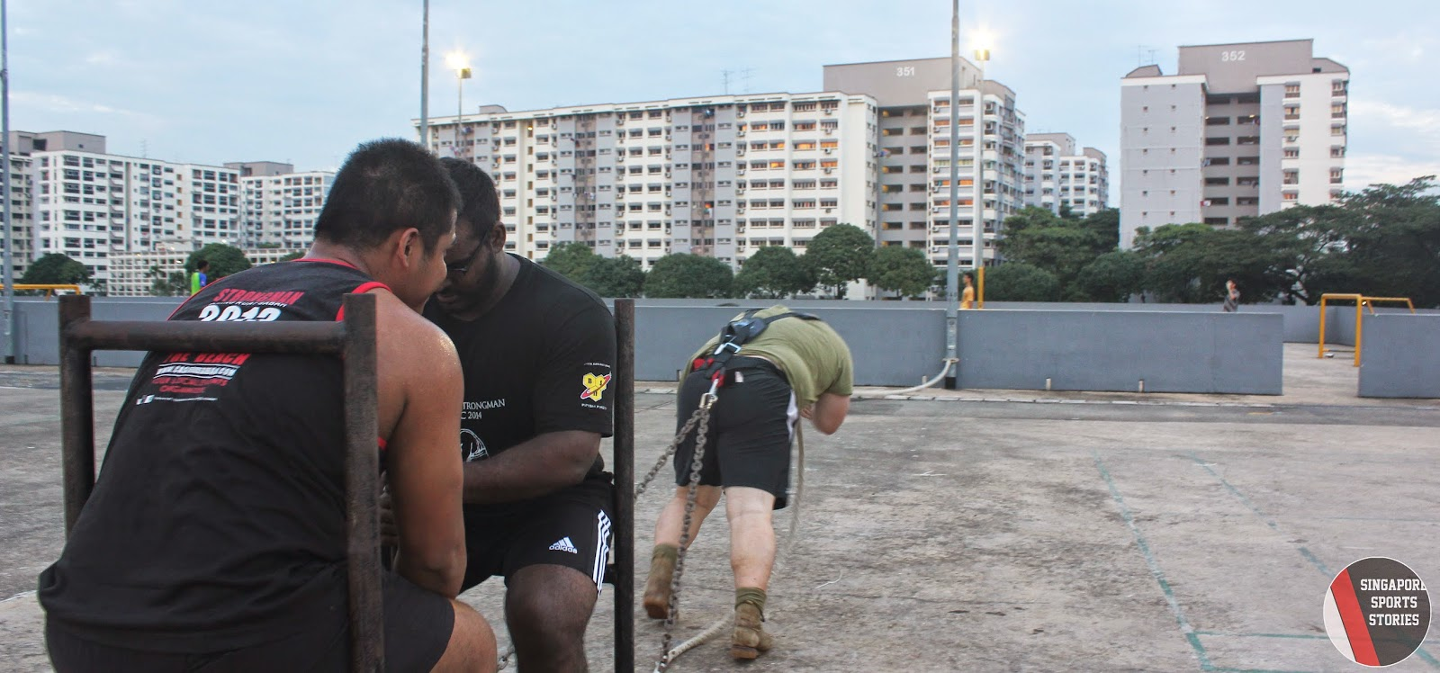 Members of Singapore Strongman group, SG Titans, performing sled pull