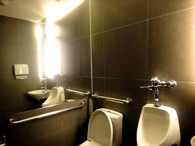Even With The Small Space, A Fully Equipped Comfort Room Is Provided. It Ha  A Modern Design, With Dark Tiles, His And Hers Toilet, Enough Paper Towels  And ... Part 87