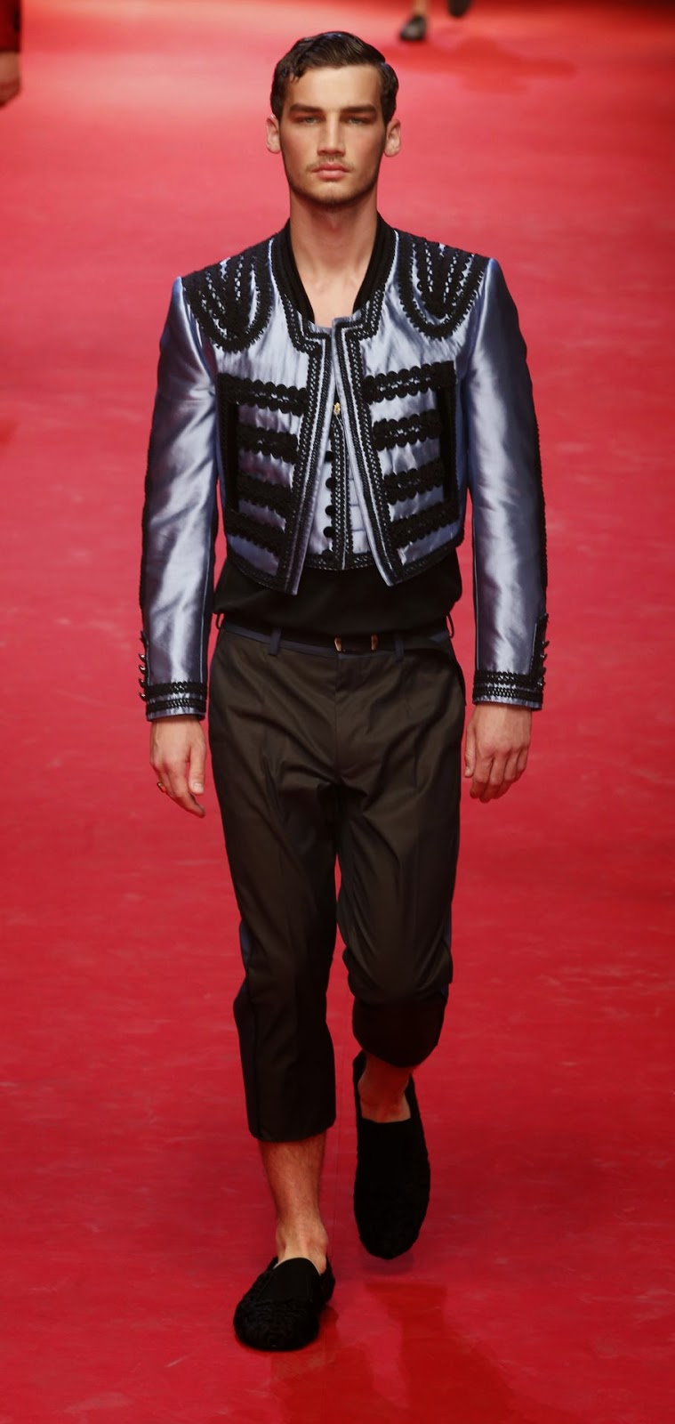 A model wears a creation for Dolce & Gabbana men's Spring-Summer 2015 collection, part of the Milan Fashion Week, unveiled in Milan, Italy, Saturday, June 21, 2014.