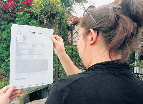 laporan polis yang dibuat ke atas Nizam