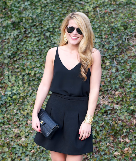 all black date night outfit with gold accessories