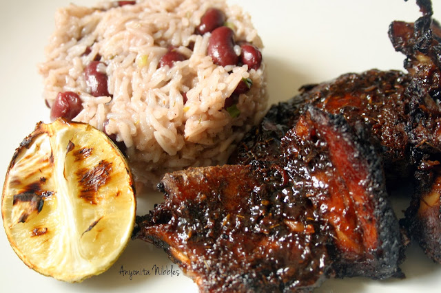 Close up of Jerk Chicken with Rice and Peas and Roasted Lime from www.anyonita-nibbles.com