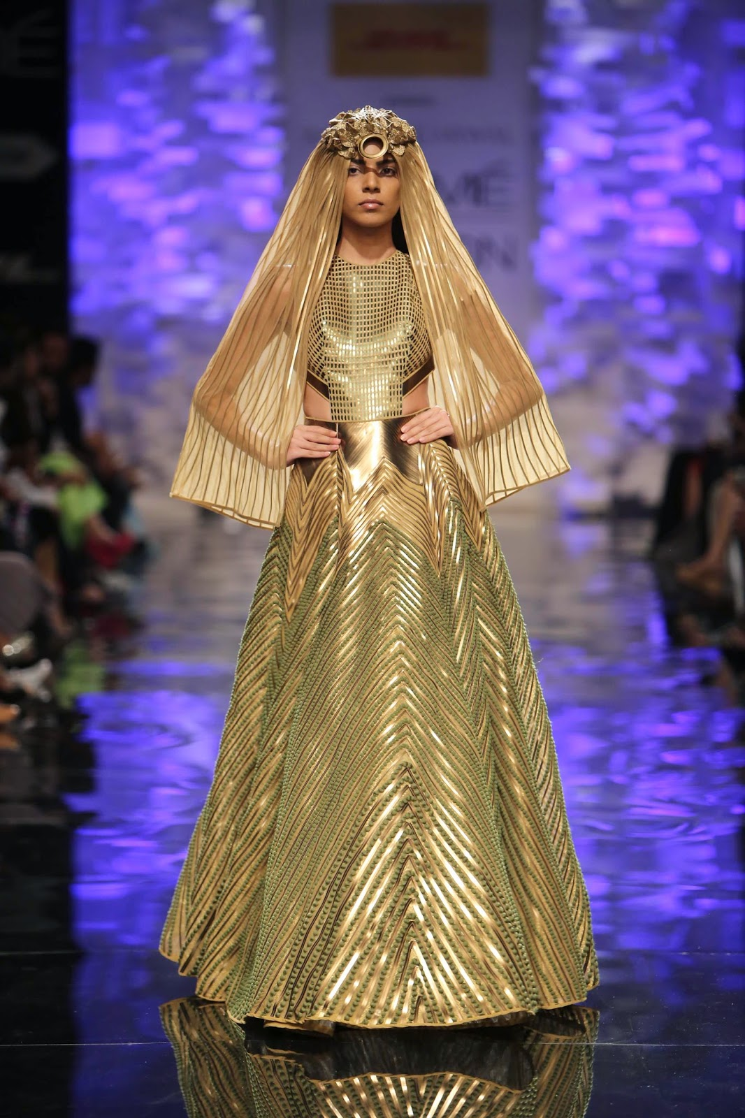 model in a gold gown....www.aquaintperspective.blogspot.com