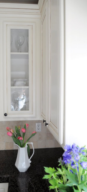 How to add glass to your kitchen cabinets for Add glass to kitchen cabinets