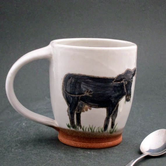 https://www.etsy.com/listing/214062659/ceramic-cow-mug?ref=favs_view_6