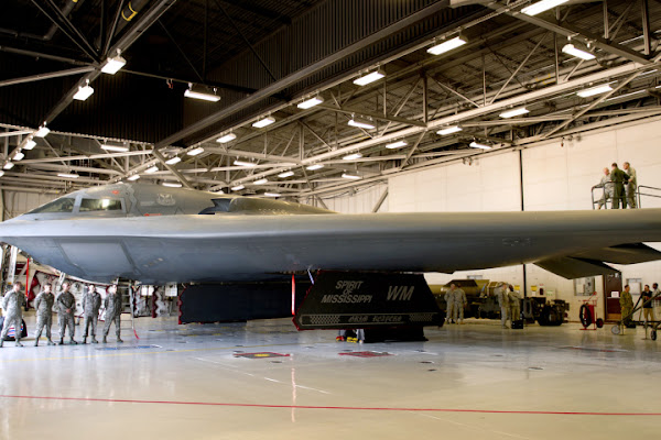 Army General Martin Dempsey, chairman of the Joint Chiefs (the leftmost of the trio atop the wing), checks out a B-2 bomber at Whitman Air Force Base in Missouri, June 18. DoD photo / D. Myles Cullen
