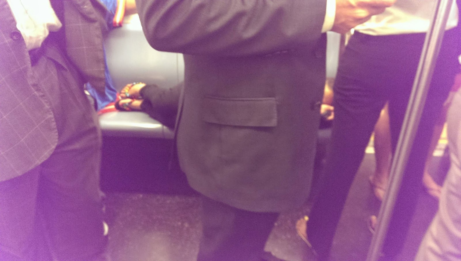 Women sleeps on subway seat as if its her bed
