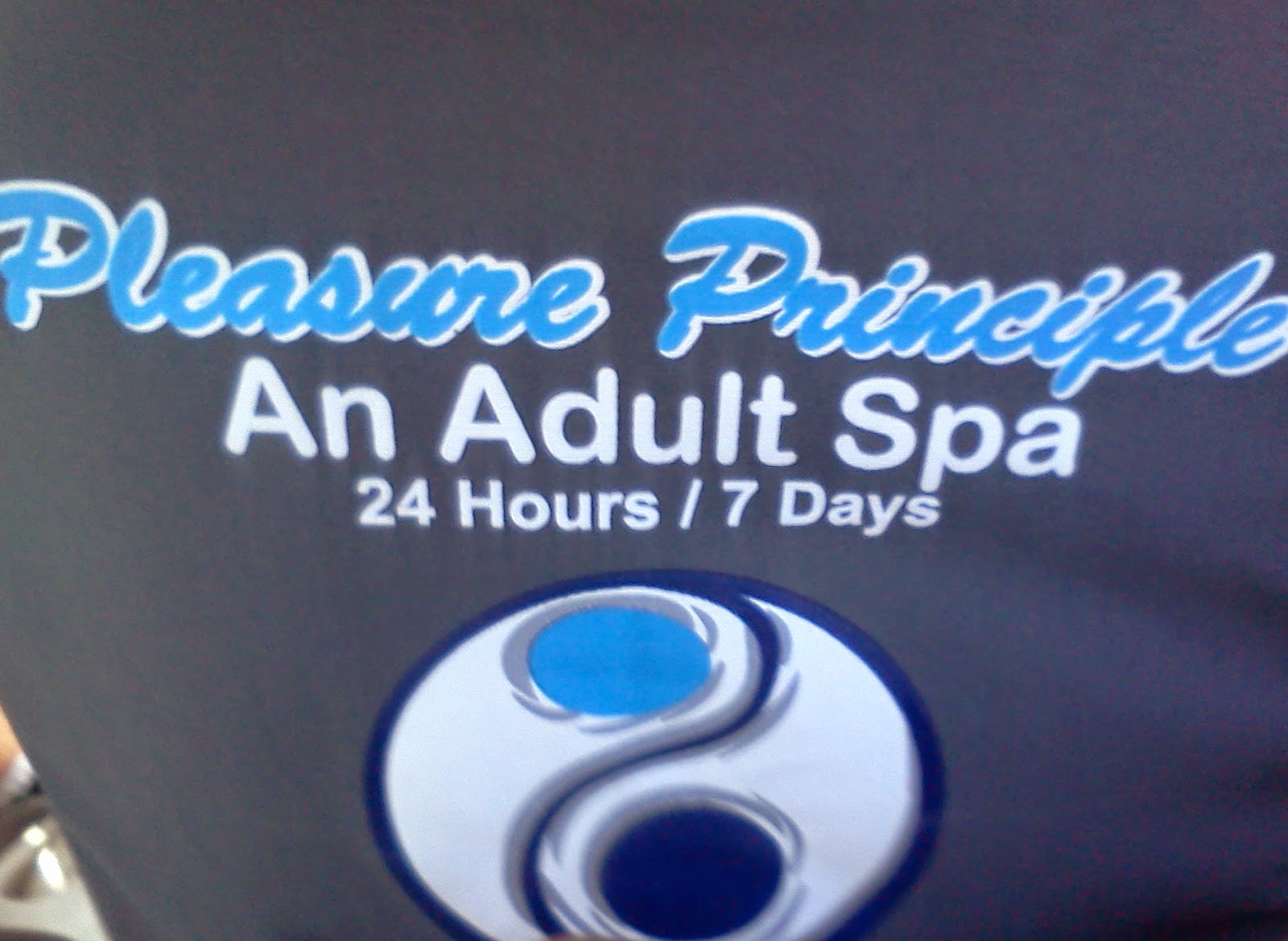 Pleasure Principle Adult Spa Ad in back of taxi
