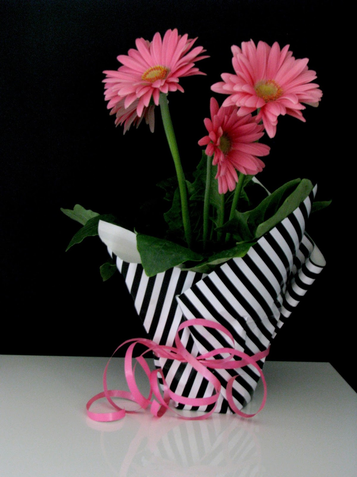 Life love larson wrapped flower i decided to keep the plant in the original pot and dress up the outside using striped wrapping paper homegoods and a little curling ribbon ikea mightylinksfo