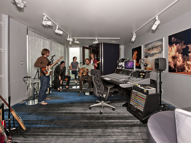Picture of male band playing in the recording studio in the guest house