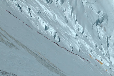 Long queue of people climbing up to the South Col on Everest