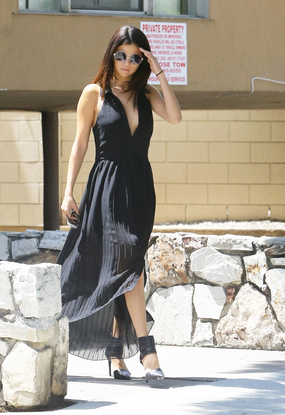 Selena Gomez steps out braless in LA in a sheer black maxi dress