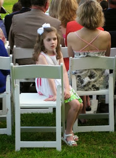 Is she thinking, This wedding's not interesting?