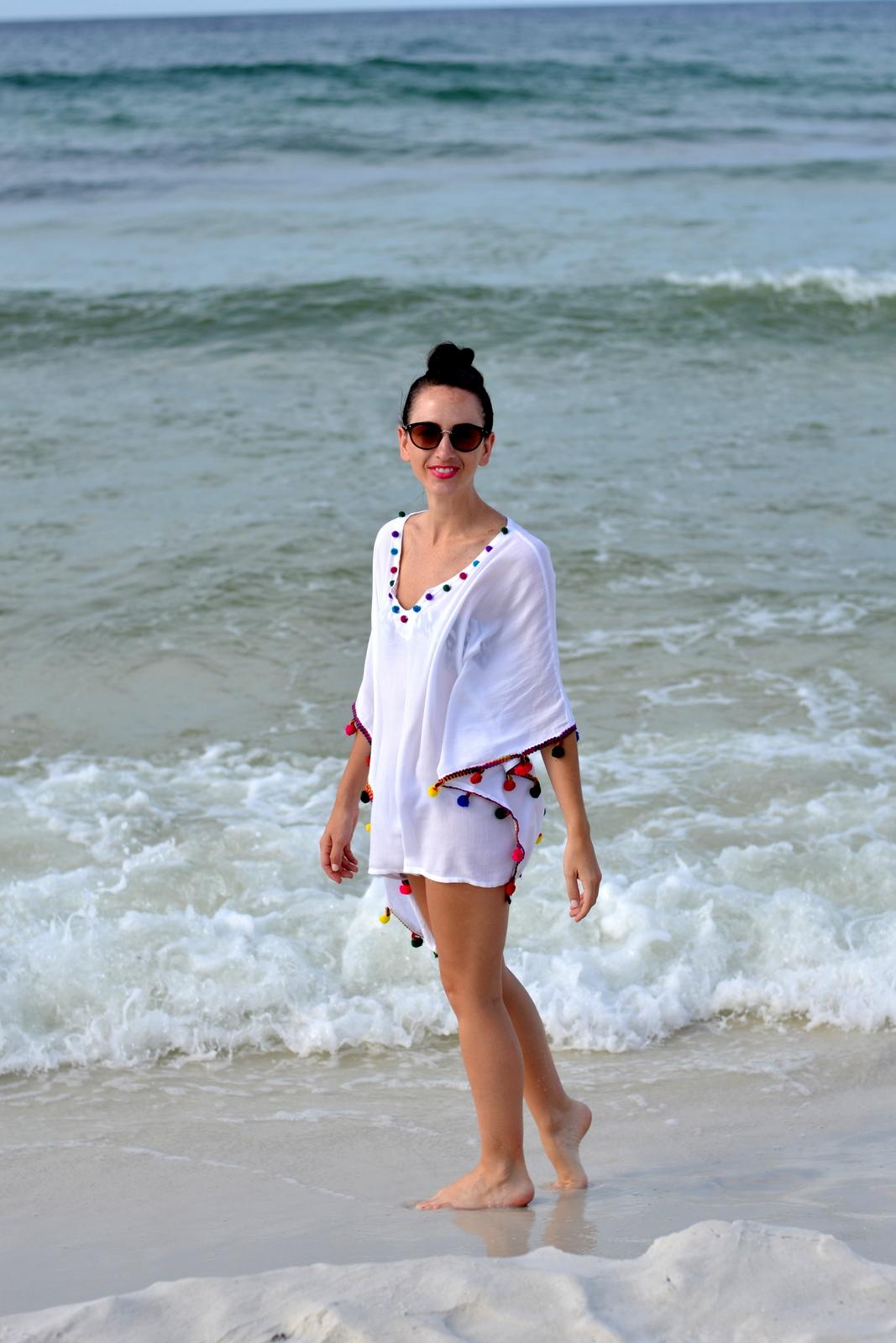 White beach coverup with bright pom poms