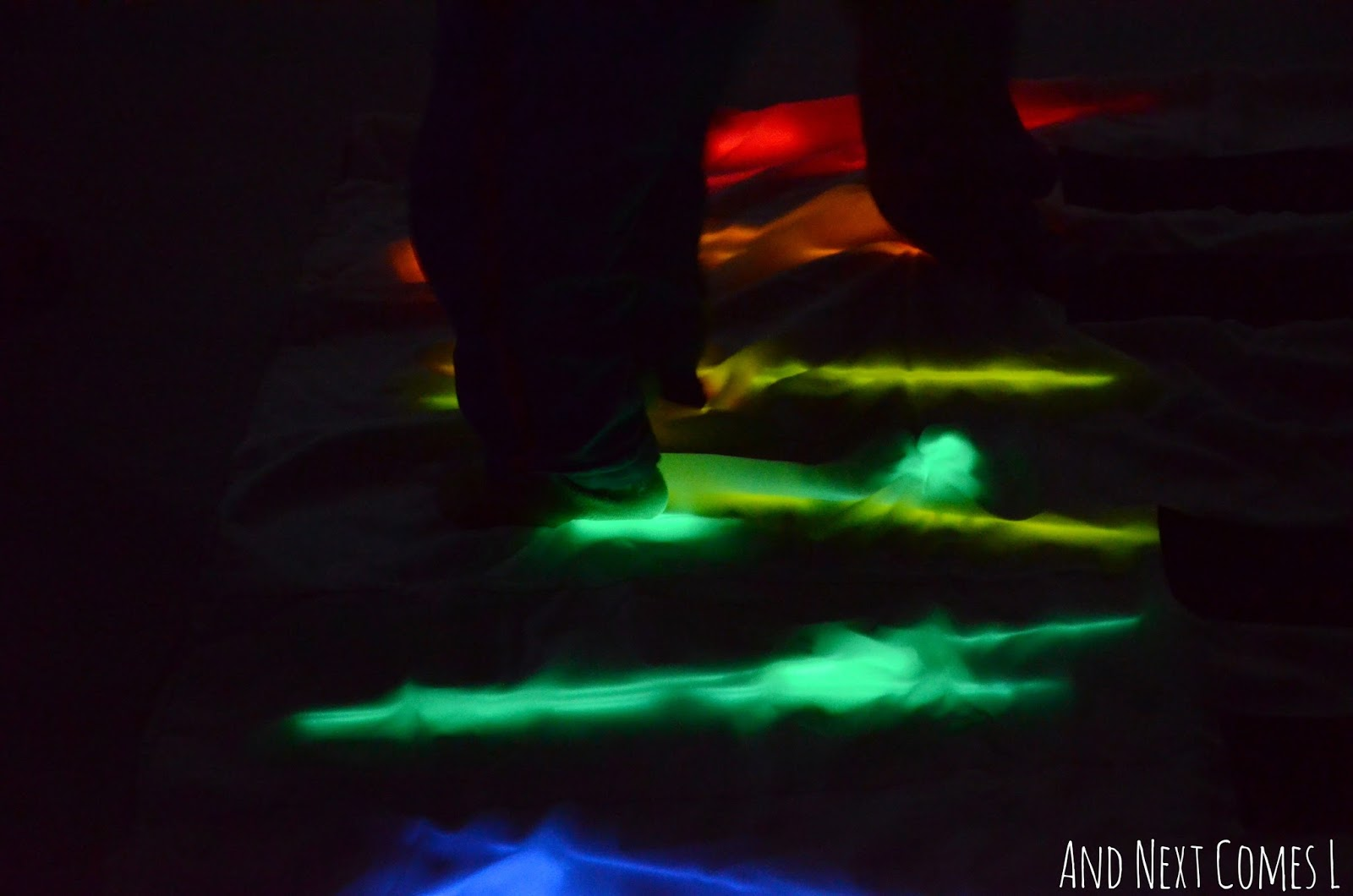 Closeup of homemade glowing floor piano from And Next Comes L