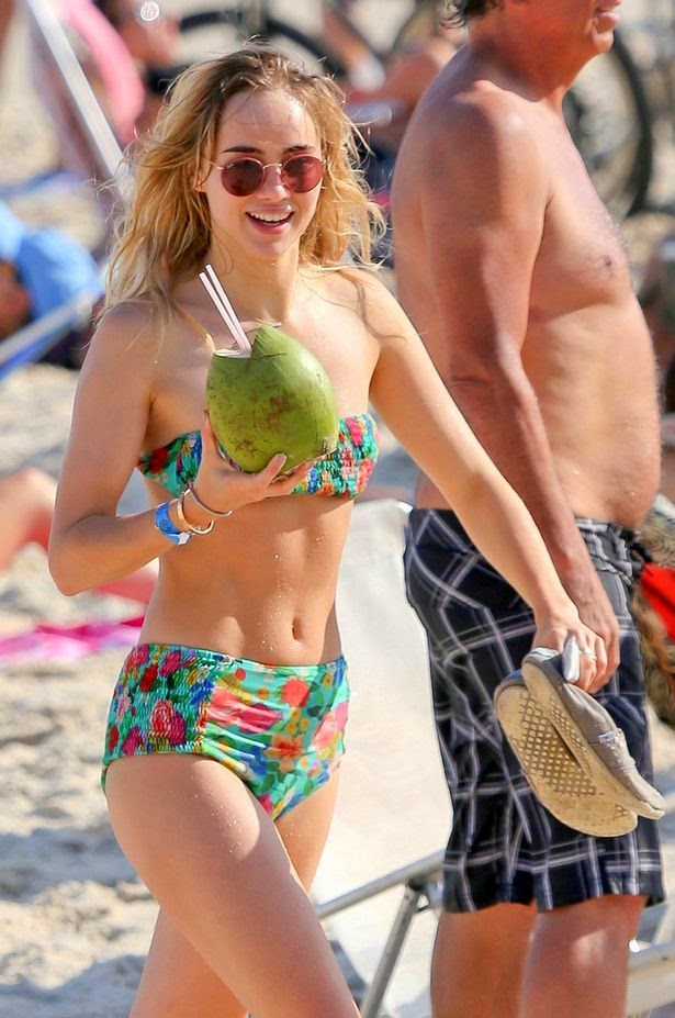 The 22-year-old displaying her own incredible figure in a retro bikini to enjoy some down time with her several friends in Brazil on Wednesday morning, September 3, 2014.