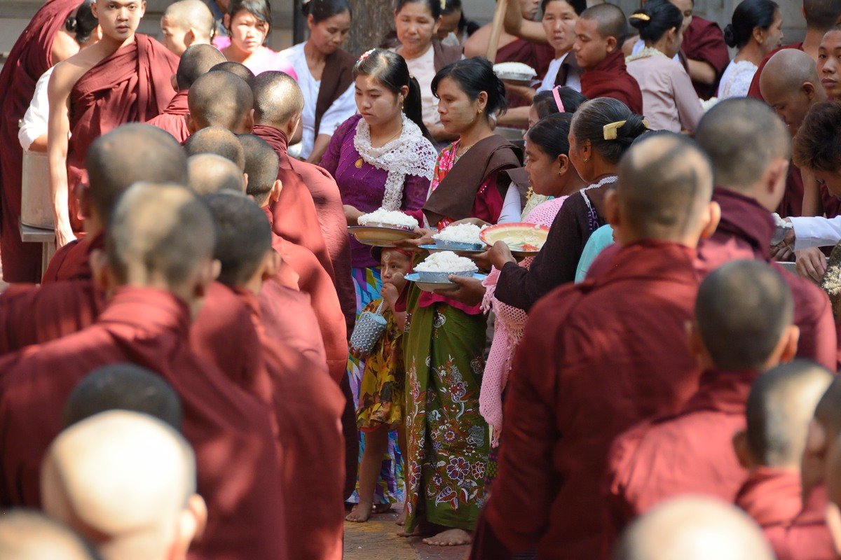 Monks receiving rice at Mahagandayon Monastery in Amarapura