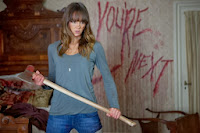 Sharni Vinson as Erin with axe in You're Next