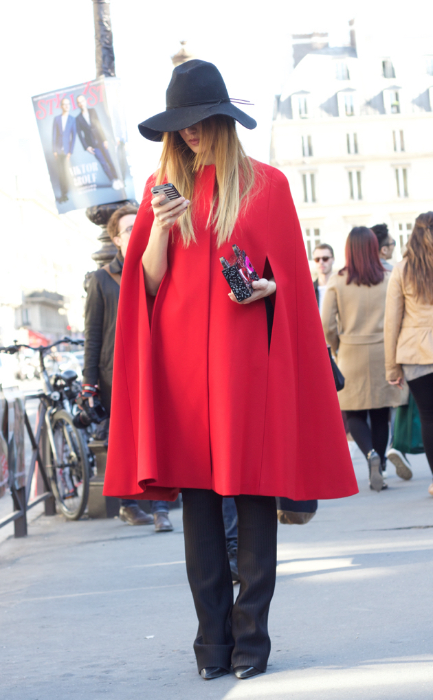 red cape jacket and black hat